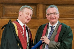 Stuart Reid (left) awards a Fellowship to Professor Kenneth Smith